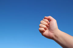 Male hand grip gesture in the blue sky Royalty Free Stock Photo