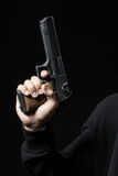 Male hand with gun isolated on black Royalty Free Stock Images