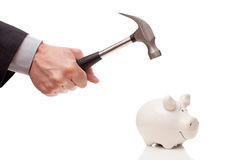 Male hand with a hammer hits a piggy Bank Royalty Free Stock Photo