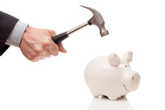 Male hand with a hammer and a piggy Bank Royalty Free Stock Photo