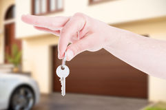 Male hand hanging house key as real estate concept Stock Photography