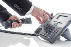 Male hand hanging up phone Royalty Free Stock Photo
