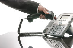 Male hand hanging up phone Stock Photos