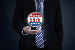 Male hand hold election symbol. Image of businessman hand holding election symbol with number 2016 Stock Photography