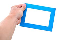 A male hand hold a empty blue photo frame isolated white.  Royalty Free Stock Photos