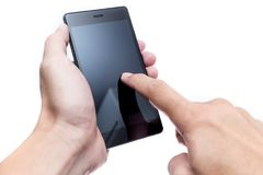 Male hand hold smartphone with finger touch screen. Black isolated on white background Royalty Free Stock Image