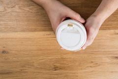 Male hand hold a take out coffee cup top view stock images
