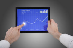 Free Male Hand Holding A Touchpad Pc, Checking Stocks Royalty Free Stock Photos - 14009088