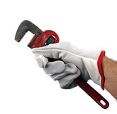 Working hands with pipe wrench Stock Photo