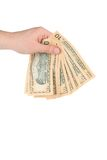 Male hand holding american dollar-bills. Royalty Free Stock Images