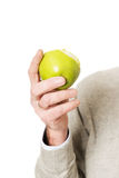 Male hand holding an apple Royalty Free Stock Photo