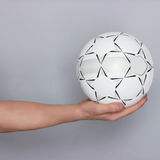 Male hand holding ball Stock Image