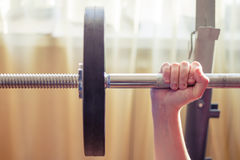 Male hand holding a barbell.  Stock Images