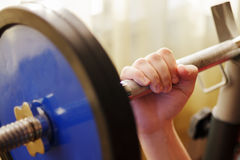 Male hand holding a barbell.  Royalty Free Stock Images
