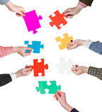 Male hand holding big blue paper puzzle piece Stock Photo