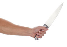 Male hand holding big silver kitchen knife. Closeup isolated on white background. Man threaten somebody with knife or trying to cook dinner. Domestic violence Stock Images