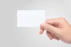 Male hand holding blank business card  Stock Images