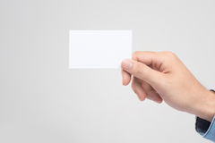 Male hand holding blank business card  Stock Photos