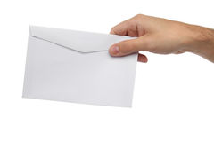 Male hand holding blank envelope isolated Royalty Free Stock Image