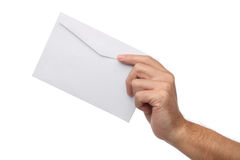 Male hand holding blank envelope isolated. On white Stock Images