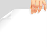 Male hand holding blank page curl Stock Image