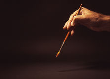 Male Hand Holding a Brush Royalty Free Stock Images
