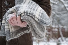 Hand With Wool Socks. Male hand holding a bunch of warm wool socks, outside cropped shot Royalty Free Stock Photo