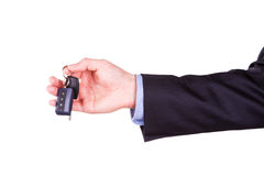 Male hand holding a car key . New car concept Stock Photo