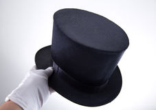 Male hand holding classic top hat Stock Photos