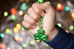 Male hand holding clover green necklace Royalty Free Stock Photos