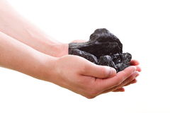 Male hand holding coal on white background Royalty Free Stock Photo