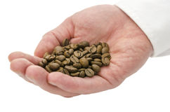 Male hand holding coffee beans Stock Photos