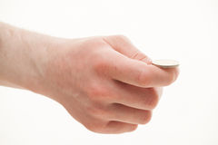 Male hand holding a coin Royalty Free Stock Photography