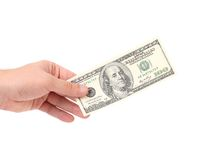 Male hand holding 100 Dollar bill. Male hand holding 100 Dollar bill - CLIPPING PATH INCLUDED royalty free stock photos