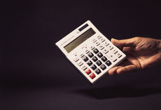 Male Hand Holding a Electronic Calculator Stock Images