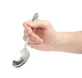 Male hand holding an empty spoon Royalty Free Stock Image