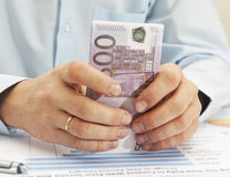 Male hand holding euro. Male hand close-up Royalty Free Stock Photos