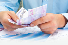 Male hand holding euro. Doing business Stock Photography