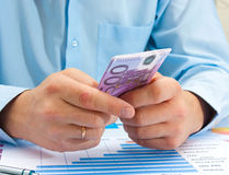 Male hand holding euro. Doing business Royalty Free Stock Image