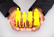 Male Hand Holding Family Cutout Shape Royalty Free Stock Images