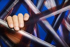 Male hand holding the film. Consumer content. Neon lighting. Male hand holding the film. Consumer content. Neon lighting royalty free stock photo