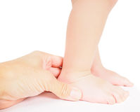 Male hand holding firmly around a foot of toddler Stock Photography