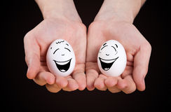 Male hand holding funny eggs Stock Photo