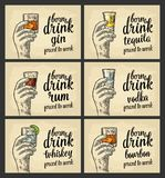 Male hand holding a glass with beer, tequila, vodka, rum, whiskey and ice cubes. Male hand holding a glass with tequila, gin, vodka, rum, bourbon, whiskey and Stock Images