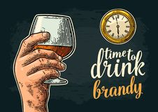 Male hand holding glass brandy and antique pocket watch. Vintage vector engraving illustration for web, poster, invitation to party. Time to Drink lettering Stock Photos