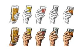 Male hand holding a glasses with beer, tequila, vodka, rum, whiskey and ice cubes. Stock Photos