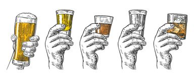 Male hand holding a glasses with beer, tequila, vodka, rum, whiskey and ice cubes. Vintage  engraving illustration for label, poster, invitation to invitation Royalty Free Stock Image