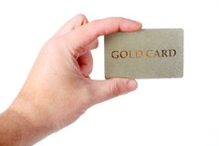 Male hand holding gold card Stock Photography