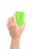 Male Hand Holding Green Cleaning Sponge on White Background royalty free stock photos