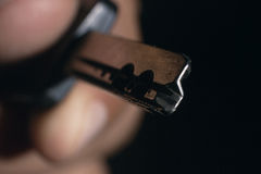 Male hand holding house key. Key in a hand. Unprotected data. Stock Image